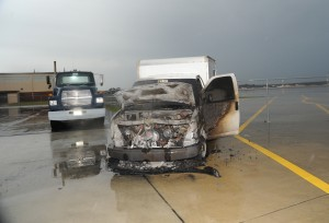 Air Force truck hit by lightning and catches fire.
